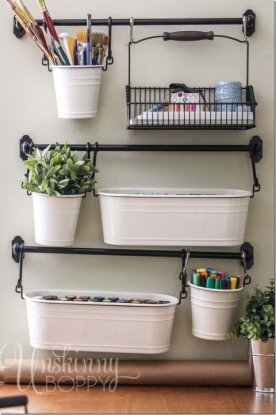 Towel bar planters and art supplies
