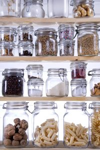 Small Pantry Containing jars Necessary To Cook