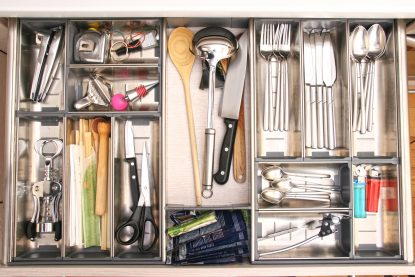 Kitchen utensils drawer full by various tools